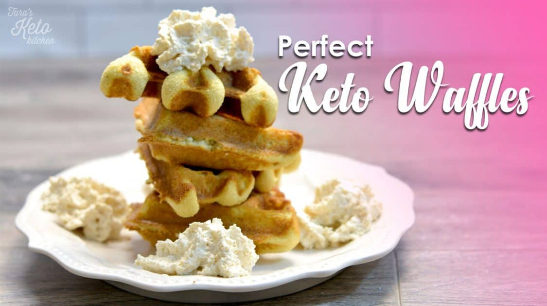"four waffle wedges on a white plate topped with real whipped cream with text ""Perfect Keto Waffles"" on image"