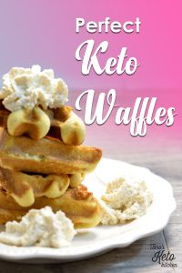 four waffle wedges on a white plate topped with real whipped cream