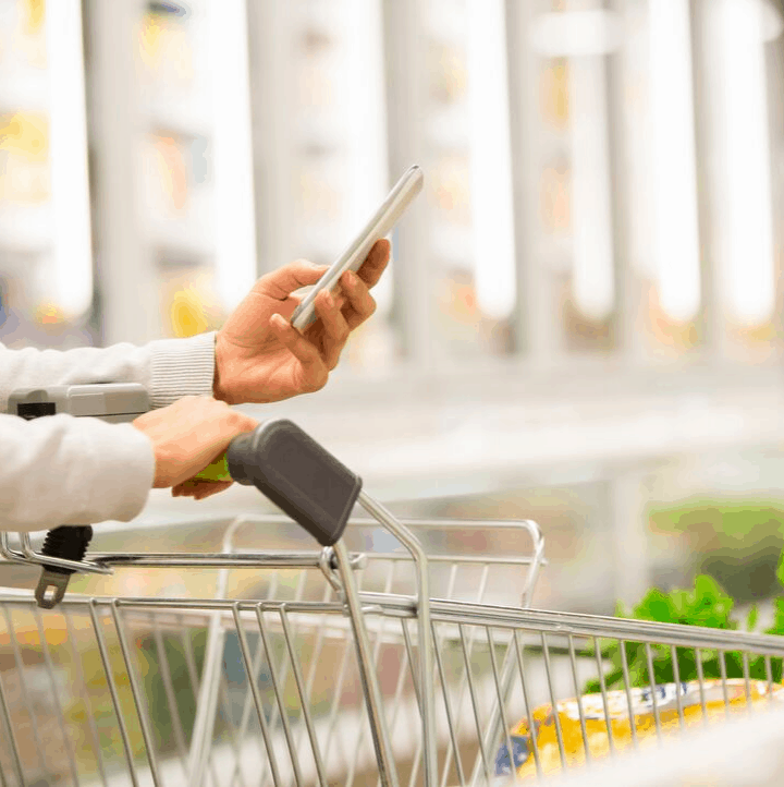 woman pushing shopping cart with keto food list