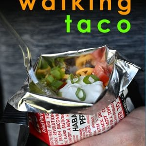 man holding a keto walking taco with sour cream and cheese