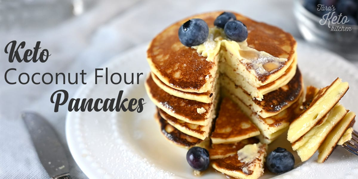 keto coconut flour pancakes overhead shot on a plate with blueberries