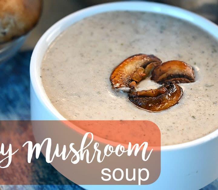 Keto Creamy Mushroom Soup on a bowl with title