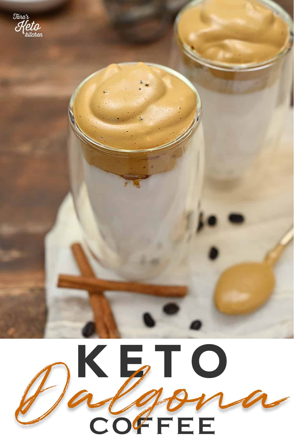 Keto Dalgona Coffee served in insulated glass tumbler with a spoonful of dalgona whip beside it.