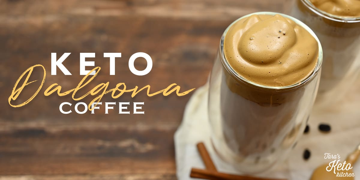 Keto Dalgona Coffee header image shown in a glass insulated tumbler with cinnamon sticks and coffee beans off to the side