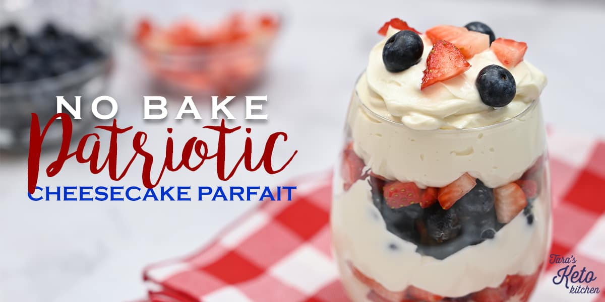 keto patriotic cheesecake parfait shown on a red and white checkered napkin with strawberries and blueberries sitting in the background