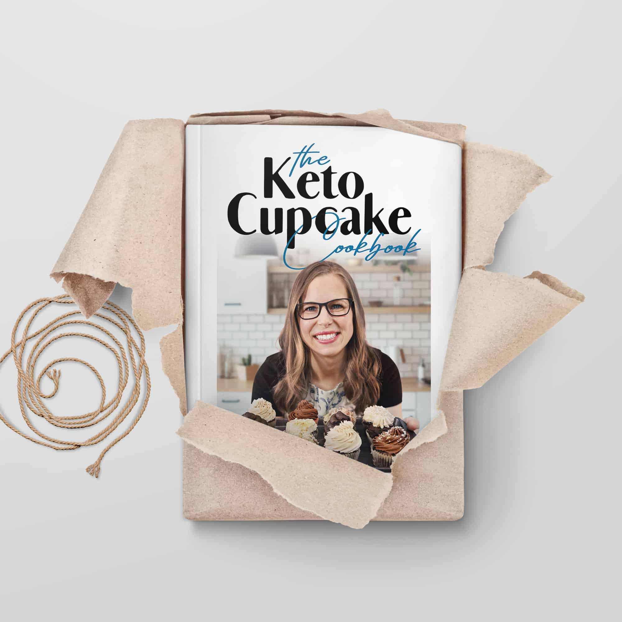 keto cupcake cookbook being unwrapped