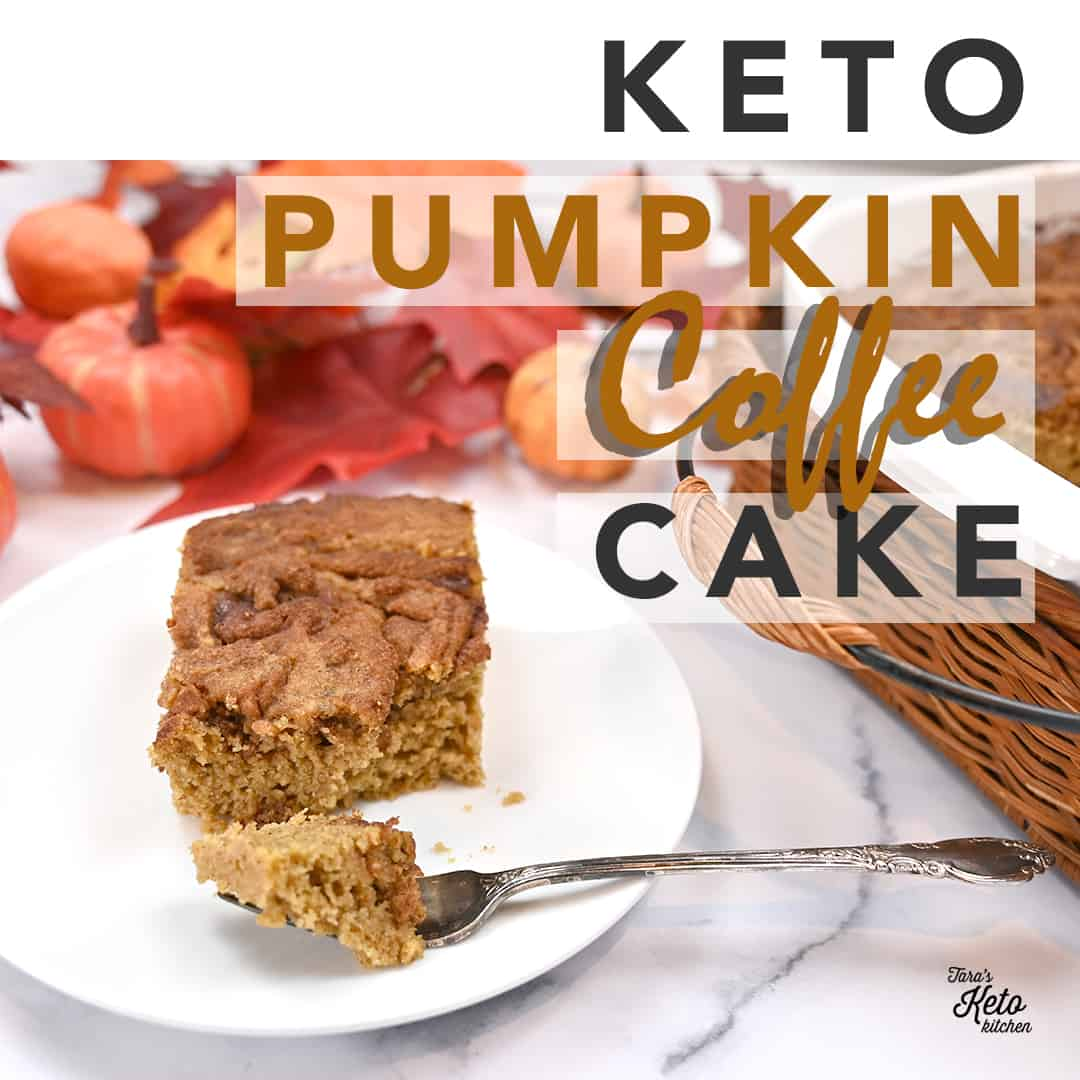 keto pumpkin coffee cake with a bite taken out of it on a white plate