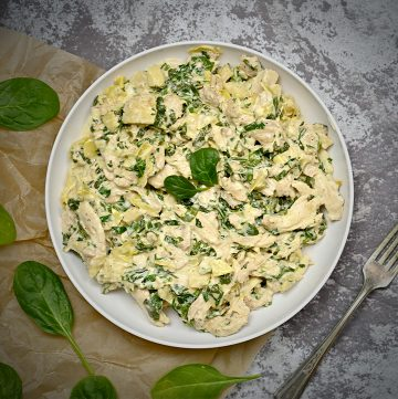 top view of keto spinach artichoke chicken in a bowl